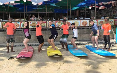 Come learn to surf with your whole family